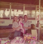 Linda Rivera, daughter Marie and brother Billy celebrate Maries birthday at Ric'Nakatani's new Cookhouse on the West Coast ShowsMidway at Bakersfield Cal ..1970's.jpg