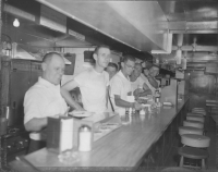 the RBBB pie car in 1964. The names written on the negative envelope are as given From Left to Right Chief's  helper waiter,Blocks, Chuck Porter,Baldy Junius, John Staley.jpg