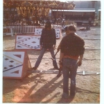 Setting up the dreaded front gate on the Carnival Time Shows 1970's.jpg