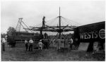 West's World Wonder Shows setting up the Merry Go Round ..early 1930's.jpg