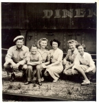 A family by the Hennis Bro's Carnival 'pie car' 1930's.jpg
