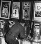 Cub Scout in the penny arcade   1940's  (naughty boy..no merit badge for you kid!!).JPG