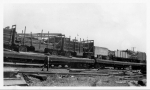 Con T. Kennedy loaded flats in a rail yard...early 1900's.jpg