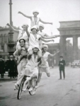 1920's Circus Performer Bike Ride In Paris