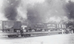 J J J flats stand idle with a wild fire burning close in the background  1930's.jpg