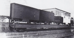 The Jones flats wait patiently on a siding for a 'fast mail' to pass... 1930's early 1940's.jpg