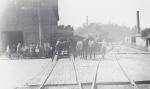 Unloading the Rubin & Cherry flats...early 1900's.jpg