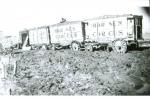 Al, G.Barnes wagons on a mud lot....1930's.JPG