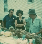 L.D. Wheeler and his wife Linda with Leo Johns carving up a lamb on the Wheeler Shows in Kentucky 1970's. That's my 40 foot semi living quarters behind them. I still have it..jpg