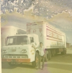 Me and the old generator truck that I must have put a million miles in. Photo taken 1970.jpg