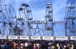 Four number. 5 Eli Ferris Wheels stretch across the Royal American Shows front gate. 1960's.