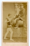 Alonzo Hiwanda holds two men & a barrel with his mouth       1865.jpg